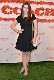 Michelle Trachtenberg opted for a fun and flirty LBD that featured a full circle skirt and a fitted top.