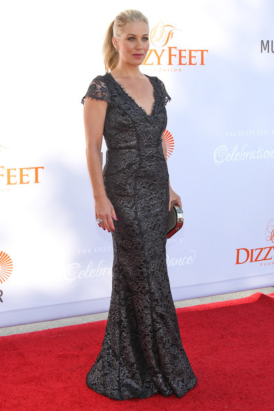 Christina's gray and black mermaid gown showed off her fit figure on the red carpet.