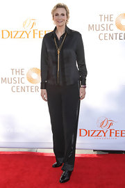 Jane's black silky pants matched the look and texture of her luxe blouse.