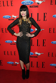 At the 3rd annual 'Elle' Women in Music event, Jessie J wore a pair of black suede ankle boots that perfectly complemented her oversize animal print long-sleeved sheath dress.