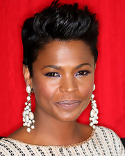 Nia Long paired her sequin wrap dress with a sleek fauxhawk that looked sensational on the actress.