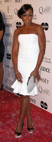 Tichina Arnold complemented her simple dress with a gorgeous fan-shaped gemstone-inlaid clutch at the Essence Black Women in Hollywood Luncheon.
