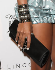 Eva Pigford held onto an elongated envelope clutch at the Black Women in Music event in LA.