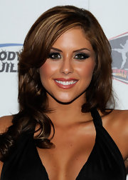 Brittney Palmer flaunted her oft highlighted curls while attending the Mixed Martial Arts Awards.