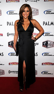 Brittney isn't afraid to show off her figure! Here she dons a low plunging black halter dress with a high slit.