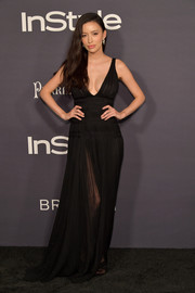 Christian Serratos oozed glamour wearing this low-cut black empire gown at the 2017 InStyle Awards.