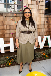 Ava Duvernay completed her neutral-toned ensemble with a pair of brown ankle-strap pumps.