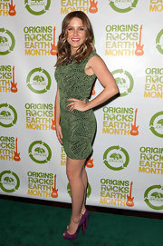 Sophia Bush stepped into a pair of tall purple suede peep toe pumps for the 3rd Annual Origins Rocks Earth Month event.