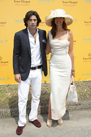 Nacho Figueras looked oh-so-handsome in his pinstripe blazer, button-down, jeans, and brown tassel loafers at the Veuve Clicquot Polo Classic.