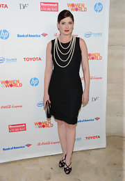 Debra Messing wore this classic LBD with pearls to the World Summit.