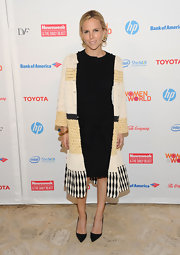 Tory Burch wore this LBD with a long statement coat to the Women in the World Summit.
