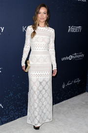 Olivia Wilde chose a long-sleeve white mixed-lace gown by Elie Saab for the unite4:humanity event.