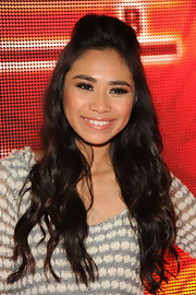 Jessica Sanchez defied gravity with this super teased half updo.