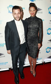 Model Denise Vasi attended the opening of 40/40 Club wearing a classic turtleneck dress.
