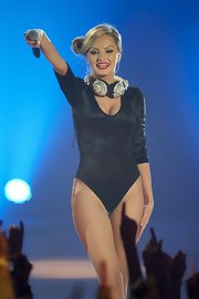 Alexandra Stan wowed the crowd in her black velvet bodysuit worn with sexy flesh-toned fishnet stockings.