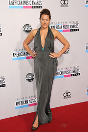 Colbie Caillat wore a halter dress with a plunging-to-there neckline at the 40th American Music Awards.