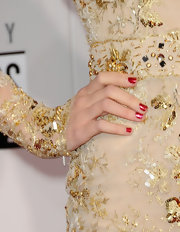 TSwift wore a ladylike red manicure at the 40th AMAs—perhaps a nod to her record-breaking album 'Red'?