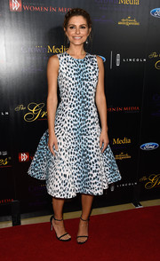 Maria Menounos chose a Dior animal-print dress in a '50s-chic fit-and-flare silhouette for her Gracies Awards look.