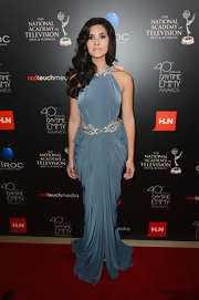 Camila looked like a Grecian goddess in this muted blue draped halter dress.