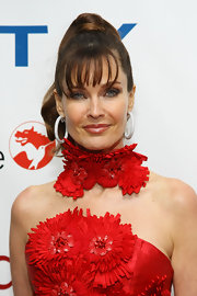 Carol Alt wore her hair in a high wrapped ponytail with long wispy bangs for the 40th Annual FiFi Awards.