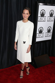 Alicia Vikander was polished in a long-sleeved white dress at the 40th Annual Los Angeles Film Critics Association Awards.