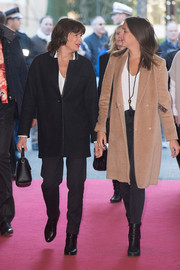 Pauline Ducruet layered a tan wool coat over a white shirt and black jeans for the 40th International Circus Festival.