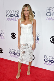 Renee Bargh turned up the heat at the People's Choice Awards in a white Misha Collection dress featuring a corseted bodice and a see-through lace skirt.