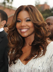 Actress Gabrielle Union showed up to the NAACP Awards rockin' a lighter hairstyle. Gabrielle's hair is normally jet black, but her highlighted brown locks light up her bronzed skin.