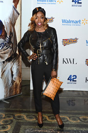 Estelle chose a classic black leather jacket with gold zipper detailing for her sleek and cool look at the '42' event.