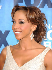 Holly Robinson Peete accented her dangling diamond drop earrings by pinning her tresses up in soft ringlet curls.
