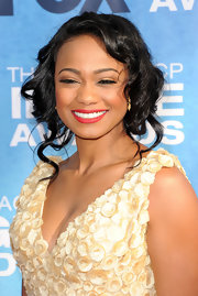 Tatyana Ali graced the carpet at the 42nd NAACP Awards sporting loose pinned up ringlets.