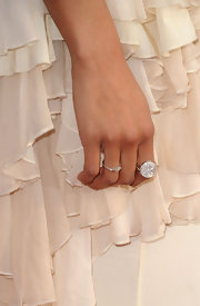 Kat Graham paired her tiered ruffle gown with a gorgeous floating diamond ring at the 42nd NAACP Image Awards.