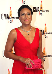 Robin Roberts paired a dainty red satin clutch with her gown for the CMA Awards.