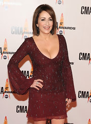 Patricia Heaton stole the show in this sexy beaded maroon mini dress with a plunging neckline at the CMA Awards.