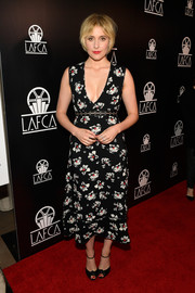 Greta Gerwig turned heads in a plunging floral midi dress by Proenza Schouler at the Los Angeles Film Critics Association Awards.