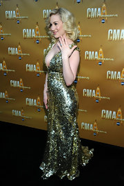 Kellie's gold spangled gown may have dazzled at the CMAs, but so did her new diamond engagement ring!