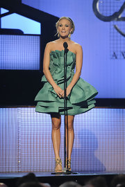 For a brief moment at the CMAs, Carrie Underwood donned this darling layered ruffle cocktail dress. The muted sea green color is exquisite!