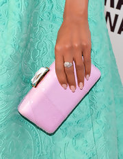 Kerry Washington accented her pastel look with a pink snakeskin Kotur clutch.