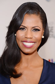 Omarosa's pearly whites popped against her fuchsia pink lipstick.