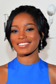 Keke Palmer complemented her updo with a pair of delicate diamond and gemstone earrings.
