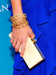 Katherine paired her beige buckled clutch with her cobalt blue dress. The added gemstone on the top was a great way to make the clutch stand out.