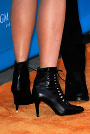 Nicole showed off her tuxedo inspired look while walking the orange carpet. She paired her odd look with lace -up ankle boots.