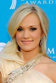 Carrie Underwood played up her soft eyeshadow with bold lashes. She completed her look with nude lip gloss.