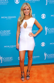 Whitney showed off her flawless figure in this white curve hugging dress, which gave us a peak into her darling assets.