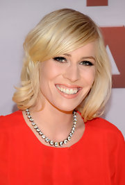 Natasha Bedingfield wore her hair with a little wave and pretty, side-swept bangs at the 45th Annual CMA Awards.