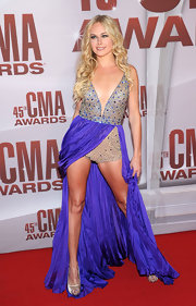 Where do we begin with this look from Laura Bell Bundy? Never the wallflower, the daring diva stepped onto the red carpet in a unique sparkling bodysuit with a purple over-skirt. Laura certainly knows how to avoid going unnoticed!