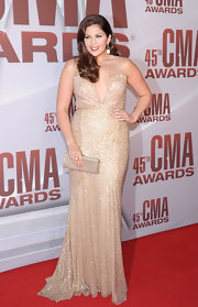 Hillary Scott of Lady Antebellum worked her curves in a shining sequin gown at the CMA Awards. Reem Acra's deep-plunging neckline paired with a delicate mermaid silhouette was the perfect choice for the talented songstress.