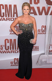 Miranda Lambert dressed her curves in a beaded strapless gown at the CMA Awards. Her dark dress featured the bejeweled bodice Miranda loves to wear. A dainty clutch and Texas-style updo were the talent's finishing touches.