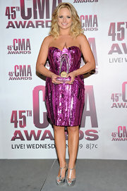 Miranda Lambert made a wardrobe change after the CMA Awards in a hot pink sequined cocktail dress.