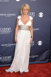 Miranda looked like a Grecian Goddess in a white evening gown with a jeweled waistline and sleeve details.